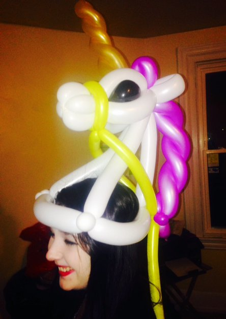 Unicorn hat balloon twisting