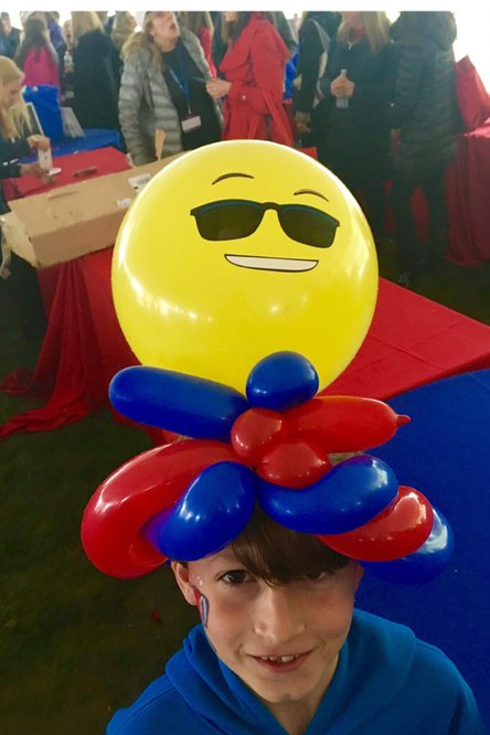Emoji hat balloon twisting