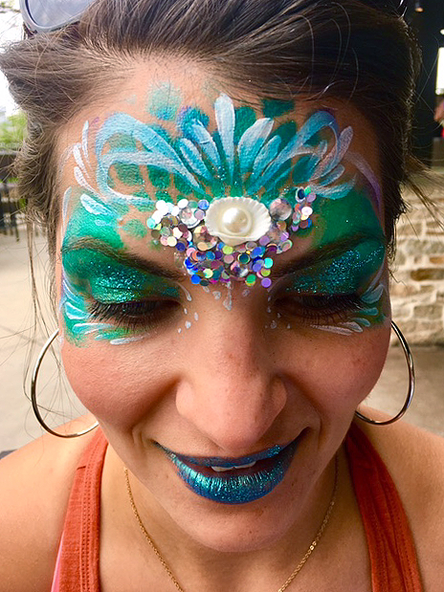 Fantasy face painting with sequins