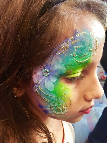 Floral face painting with sequins