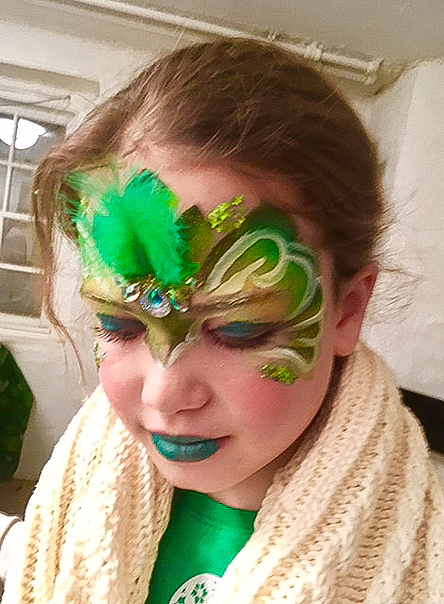 Fancy green Mask face painting with sequins and plumage