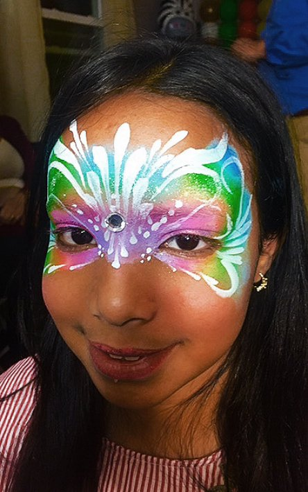 Beautiful rainbow butterfly face painting