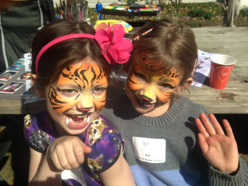 Two Girls with Tiger face painting